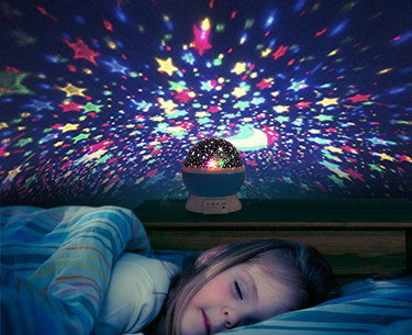 LED Star Ceiling Projector With Sleeping Child