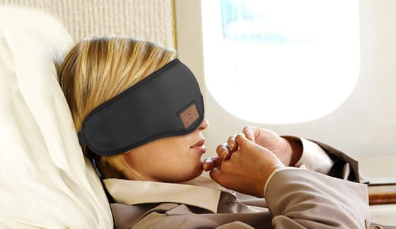 Black Sleep Headphones With Woman On Plane
