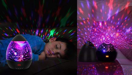 Night Light Projector With Blue Stars On Wall