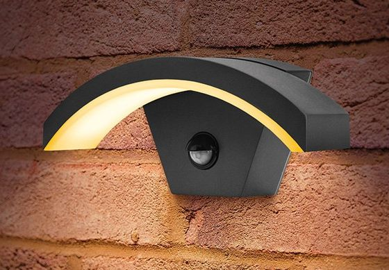 Curved External Bulkhead Light On Brick Wall