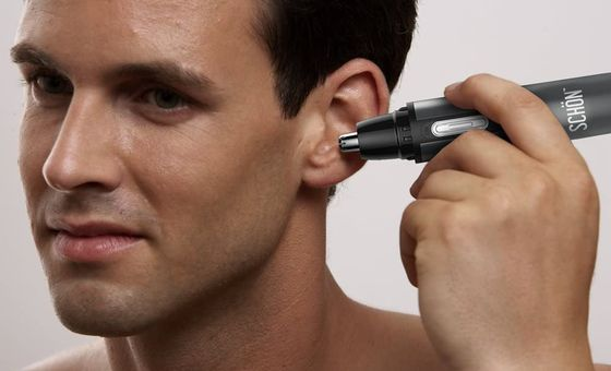 Nose And Ear Trimmer In Man's Ear Canal
