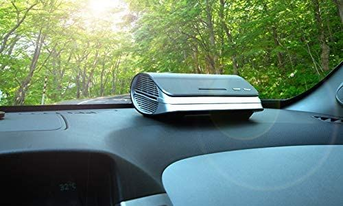 Car Ozone Air Purifier And Ionizer On Dashboard