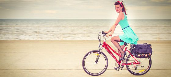 Girl On Bike On Sand