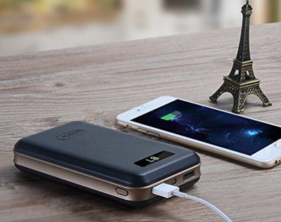 Portable Mobile Charger In Black With White Cable