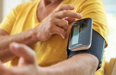 Blood Pressure Monitor In Black On Man's Upper Arm