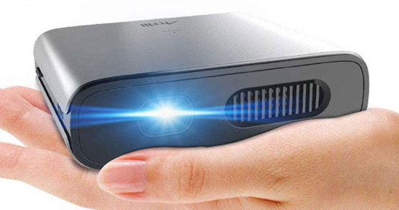 Small Pocket Projector In Womans Hand