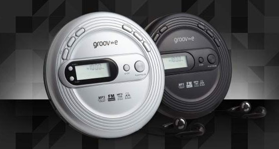 Small Radio CD Player With Black Earphones