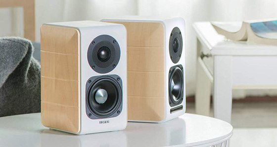 White Bookshelf Speakers On Table