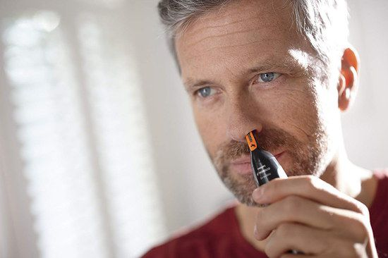 Electric Nose Hair Trimmer In Mans Hand