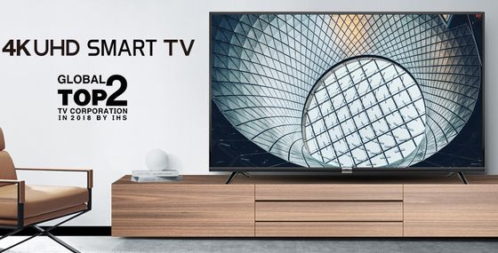 UHD TV On Wooden Sideboard