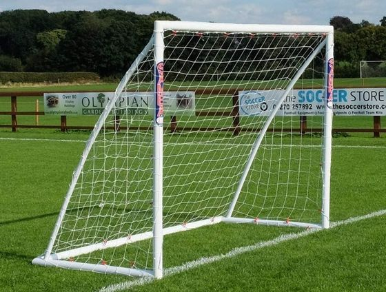 Portable Locking Football Goal Posts On Grass