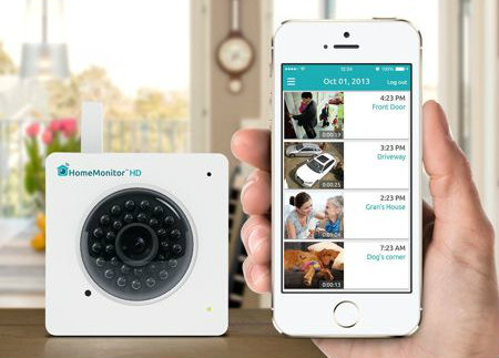 The Y-cam HomeMonitor in a Hand