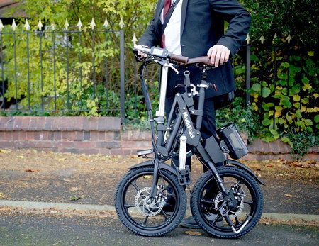 Fold Up Electric Bike Carried By Man