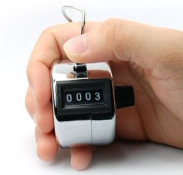 Hand-Held Digital Tally Counter In Man's Hand