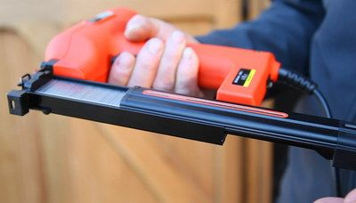 Electric Powered Hand Staple Gun In Man's Hand